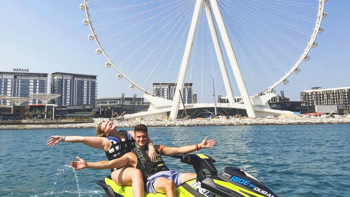 Couple riding a jetski in Dubai